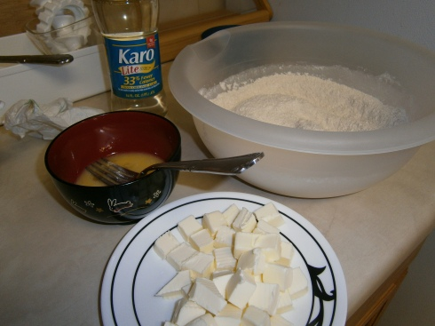 The cast of characters: dry ingredients (flour, sugar, spices, leavener), cold butter, egg, and karo syrup.