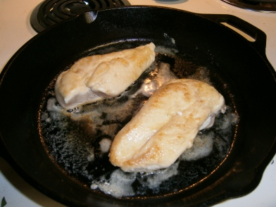 The chicken is dredged in seasoned flour and sauteed for a few minutes. And yes, I used real butter and grapeseed oil for this. Spray oil is not enough for a cast-iron skillet. Lubrication is key.