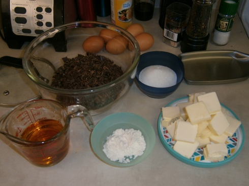 Semi-sweet chocolate, eggs, sugar, butter, flour, and bourbon. A recipe for ultimate decadence?