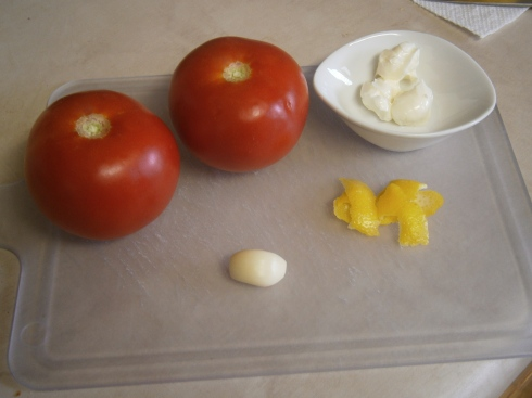 Tomatoes, lemon peel, garlic, and some butter to cook it all in.
