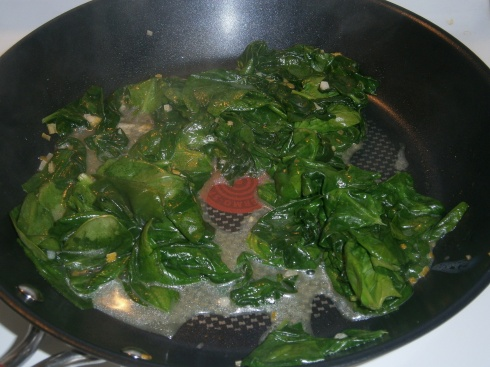 Spinach, wilting happily away with some garlic, lemon, and (more) butter.