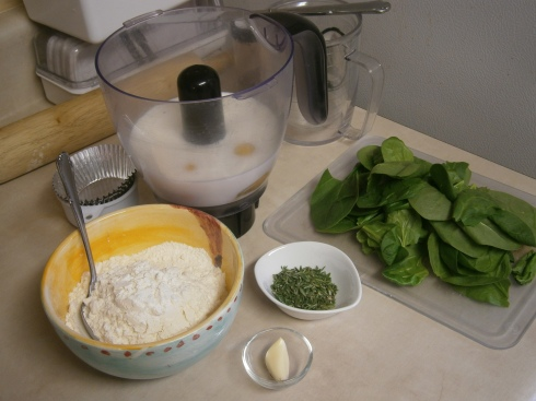 Milk, eggs, flour, herbs (fresh rosemary and thyme), garlic, and spinach.