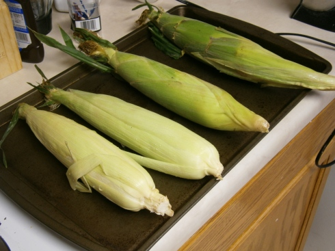 Preheat oven to 400 degrees F. Prep corn by setting it nearby.