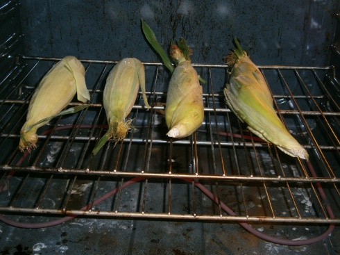 When the oven is hot, place corn directly on the oven rack. Cook for 20 minutes, turn over, and cook for another 20 minutes.