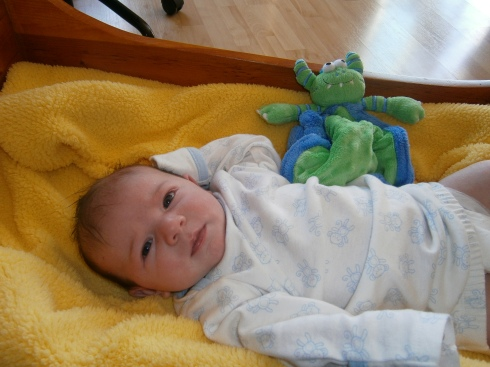 Two-month old Hannah with her monster lovey.