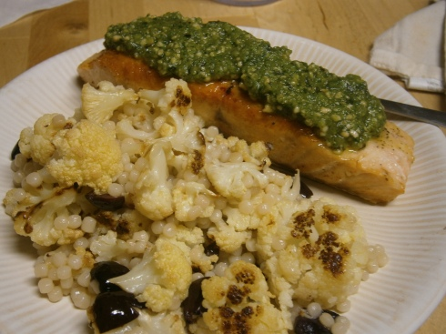 Salmon with cashew pesto and Israeli couscous with roasted cauliflower and olives.